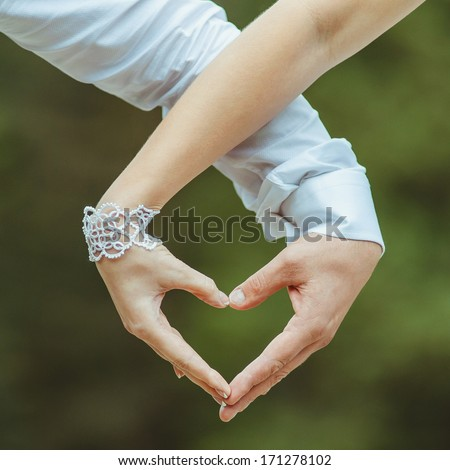lovers couple making a heart with hands - stock photo
