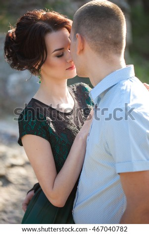 Lovers girl and guy near the cliffs and the sea