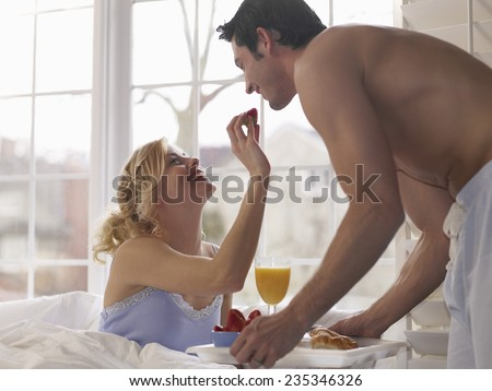 Lovers Have Breakfast in Bed - stock photo