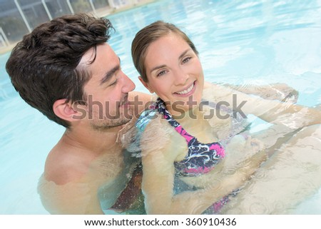 lovers in the swimming pool