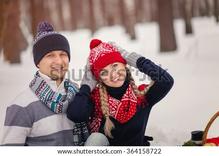 Lovers man and woman in knitted woolen winter clothes on Valentine's day in winter Park. - stock photo