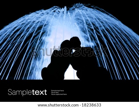 Lovers nex to the blue fountain - stock photo
