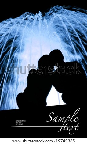 Lovers next to the blue fountain - stock photo