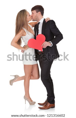 Lovers showing affection. Isolated on white background - stock photo