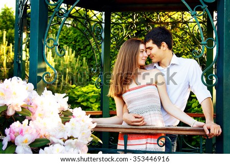 Lovers young man and woman walking in the summer park - stock photo