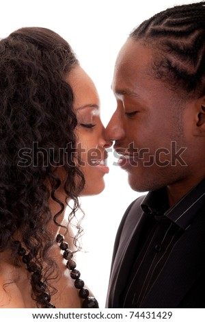 Loving African American couple looking at each other - stock photo