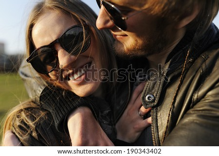Loving and happy couple embracing and laughing - stock photo