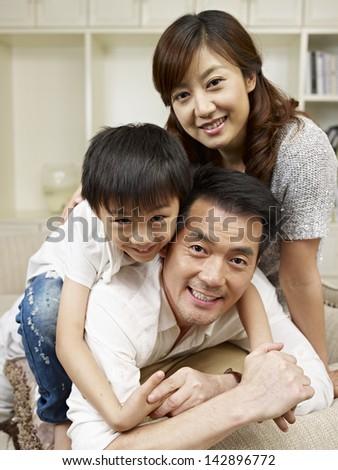 loving asian family having fun at home. - stock photo