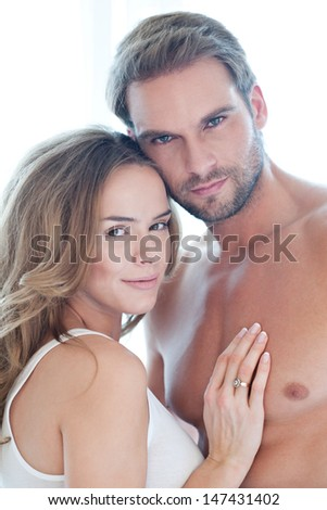 Loving beautiful couple isolated on white - portrait - young, caucasian - stock photo