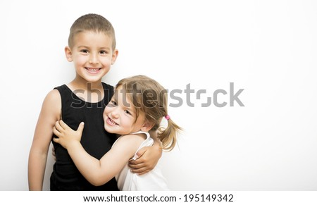 Loving brother and little sister - stock photo