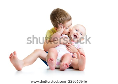 Loving brother kissing his little sister isolated on white - stock photo