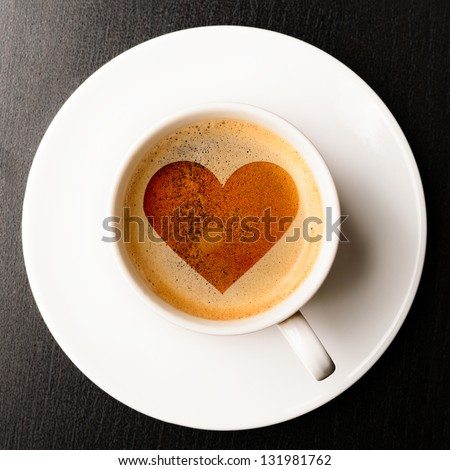 loving coffee. cup of fresh espresso with heart sign, view from above - stock photo