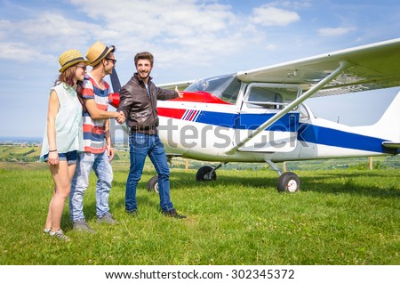 loving couple are ready to go for their vacation, they greet the pilot - transportation and holiday concept