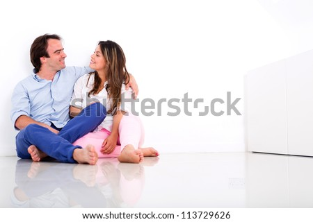 Loving couple at home enjoying time together - stock photo