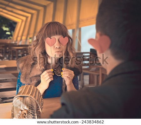Loving couple at restaurant with red heart - St.Valentines Day concept - stock photo