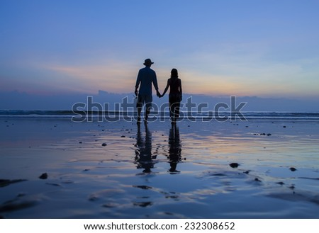 Loving couple at sunset Ngwesaung beach, Myanmar. Burma - stock photo
