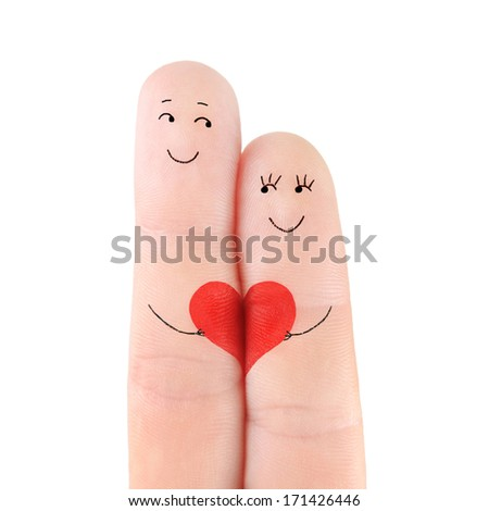 Loving couple concept - a man and a woman hold on the red heart, painted at fingers and isolated on white background - stock photo