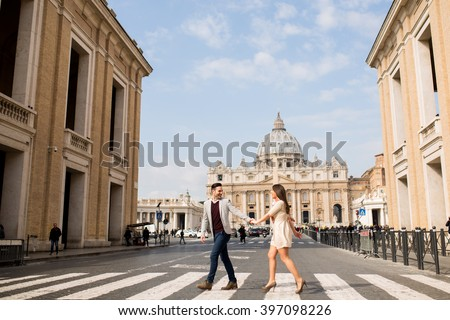 Loving couple crossing the street in Rome - stock photo