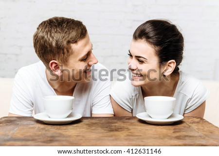 Loving couple drinking coffee in the morning for breakfast