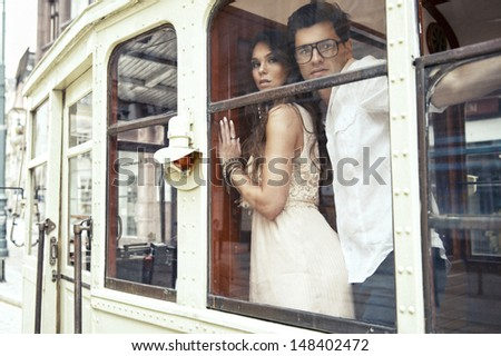 Loving couple embraces in tram - stock photo