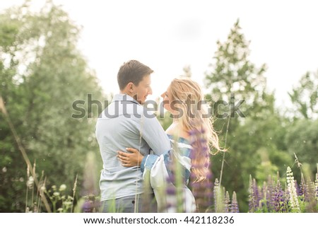 loving couple embracing each other in nature