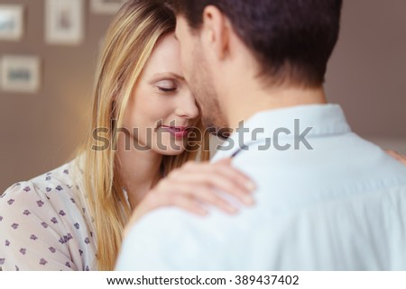 Loving couple enjoy a tender moment as they rest their foreheads together with their eyes closed in bliss - stock photo