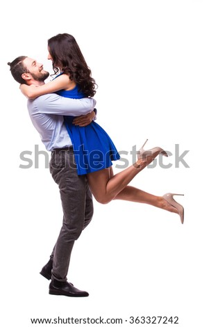 Loving couple having fun while piggyback ride isolated over white background - stock photo