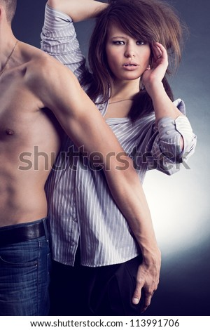 Loving couple in a passionate embrace. - stock photo
