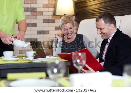 Loving couple in a restaurant - stock photo