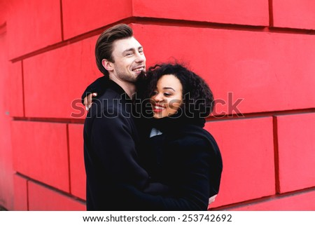 loving couple in a winter day in the city,  and caucasian man - stock photo