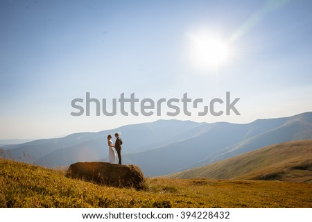 Loving couple in an embrace on mountain
