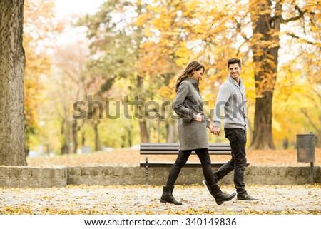Loving couple in the autumn park - stock photo
