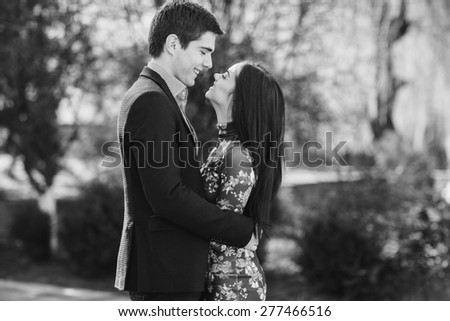 loving couple in the park - stock photo