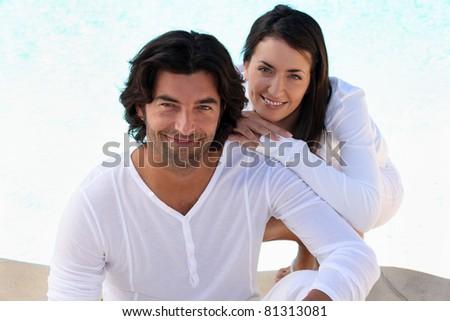 Loving couple in white on a bright sunny day - stock photo