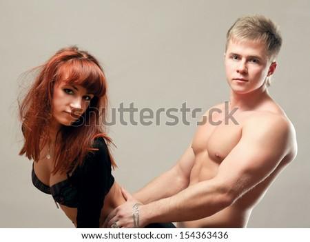 Loving couple isolated on white background - stock photo