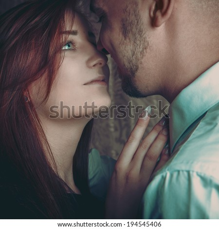 loving couple looking at each other in studio - stock photo