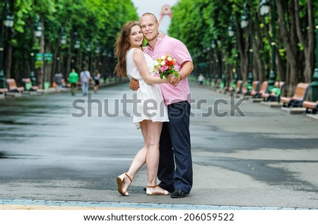 Loving couple on a walk - stock photo
