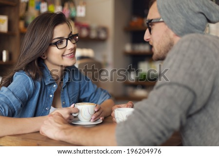 Loving couple on date at cafe  - stock photo