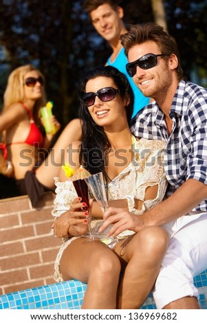 Loving couple on summer holiday at swimming pool. - stock photo