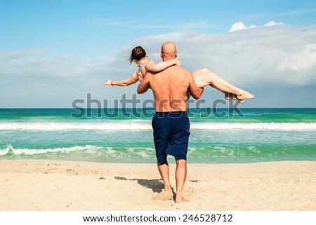 Loving couple on the sea beach - stock photo