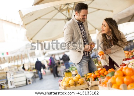Loving couple picking fuits in Rome, Italy - stock photo