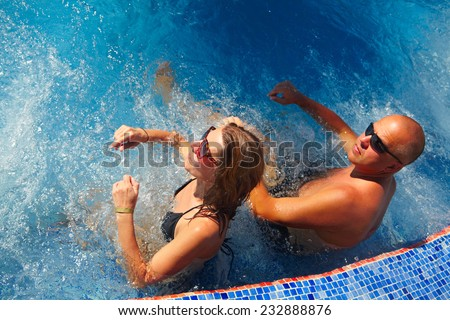 Loving couple relaxing in jacuzzi. Summer vacation