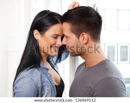 Loving couple smiling at each other - stock photo
