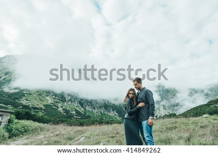 loving couple standing on the road