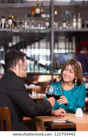 Loving couple toasting and enjoying a romantic dinner - stock photo