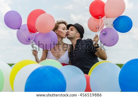 loving couple with balloons