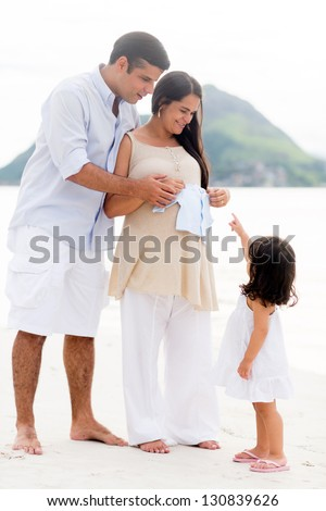 Loving family expecting the arrival of a new baby - stock photo