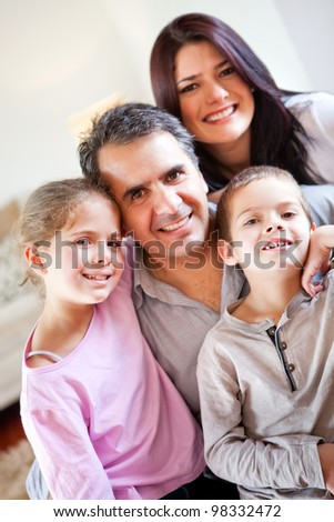 Loving family portrait together at home smiling - stock photo