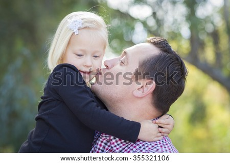 Loving Father Kissing Adorable Little Girl Outdoors. - stock photo