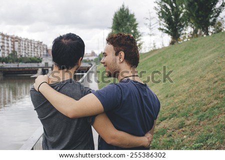 Loving gay couple in outsite